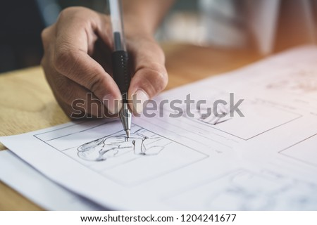 Storyboard or storytelling drawing creative for movie process pre-production media films script for video editors, Student hand writing graphic organizer in form of illustrations displayed in sequence