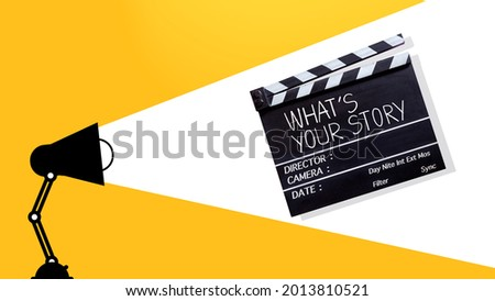 Storytelling concept.Handwriting on film slate or clapperboard. Cinema production of media industry concept. filmmaking equipment. Сток-фото ©