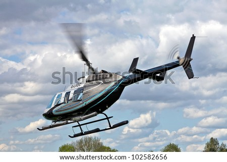 STOTFOLD, ENGLAND - MAY 12: Helicopter leaving the ground to give sightseeing trips to paying customers of the North Herts countryside at the Stotfold Steam & Country fayre on May 12, 2012 at Stotfold