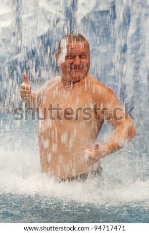 stock-photo-stout-man-taking-a-shower-94717471