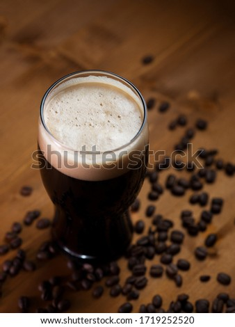 stout or porter with coffee on a wooden pub table Stock photo ©