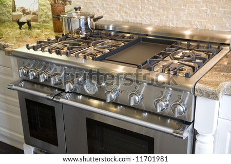 Stove and oven in a luxury home kitchen. - stock photo