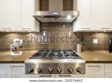 Stove closeup in modern kitchen interior with stainless steel gas cook-top. Сток-фото ©