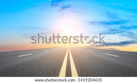 Straight asphalt road and sunset sky Stock photo ©