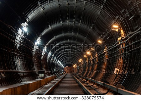 Straight circular subway tunnel with tubing and two different lights: white and yellow #328075574
