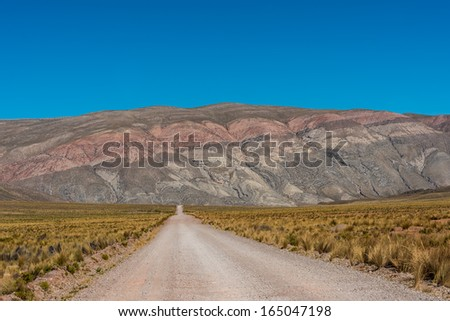 straight dirt road in the peruvian Andes at Arequipa Peru