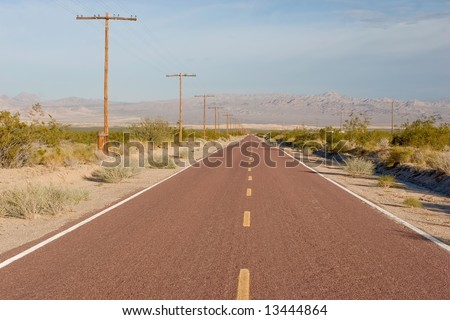 straight, empty road in the middle of nowhere. Mojave National Preserve, California