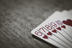 straight flush. handing rank in texas poker. Risk game abstract. Money win.