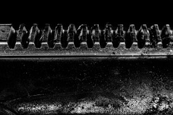 Straight metal gears of industrial machinery grime and greasy in black and white