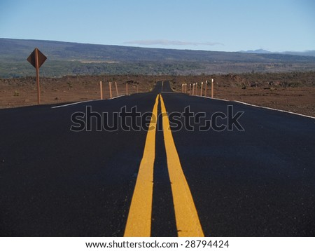 Straight road at Kilauea volcano,Hawaii - stock photo