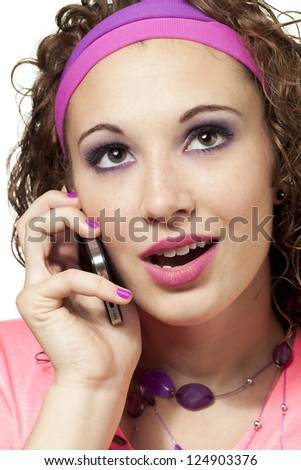 Straight shot of a girl talking on her cell phone