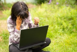 Strain farmer in park. Farmer using laptop computer and grasping the temples with your hands because headache grimacing. from fail loss business. wrong work  agriculture concept.