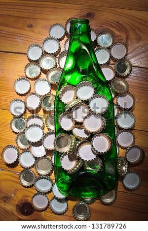 strained bottle among metal lids