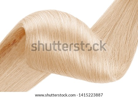 Stranded blond hair as background, isolated on white