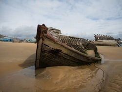 Stranded broken wooden shipwrecks on fishing boat ship naval graveyard marine cemetery in Magouer Etel river Quiberon Lorient Morbihan Brittany France Europe