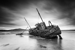 Stranded on the beach. Shipwreck at Gortmelia Strand, Co. Mayo, Ireland