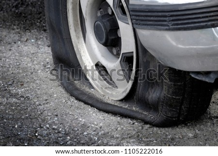 Stranded with a flat tire on roadway car vehicle cannot move