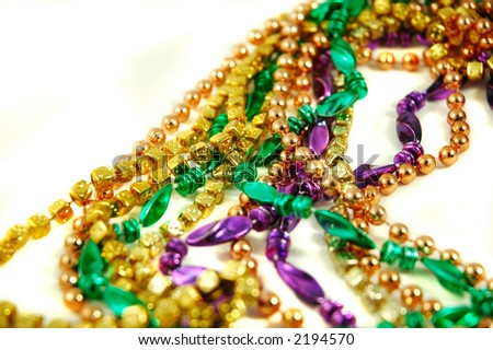 Strands of Mardi Gras beads isolated on a white background
