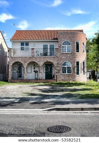 strange house with red bricksand manhole cover #53582521