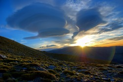 Strange, lenticular clouds over sierra nevada mountains, spain