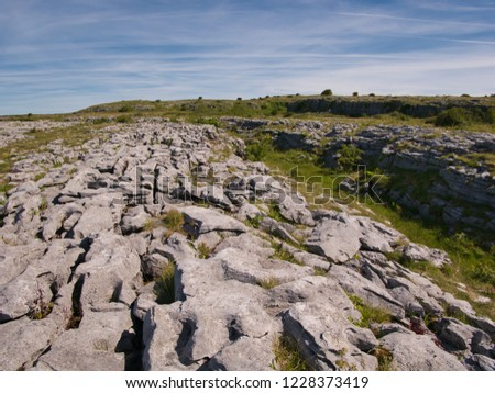 Strange rocky landscape with crevices and grooves at Poulnabrone in Ireland