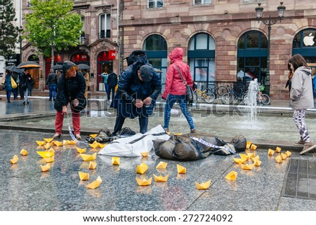 STRASBOURG, FRANCE - APR 26 2015 Arranging Frontex line over dead corps protest against immigration policy and border management which asks for commitment in the wake of migrants boat disasters