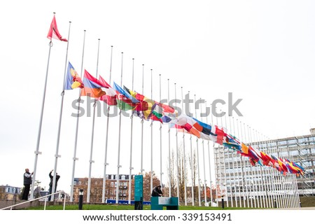 STRASBOURG, FRANCE - 14 Nov 2015: All European Union Flag flies at half-mast in front of the Council of Europe following an terrorist attack in Paris