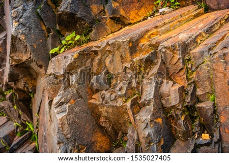 Strata of foliated homogeneous metamorphic rock derived from sedimentary rock.They  form from tectonic processes as continental collisions, which cause horizontal pressure, friction & distortion.   #1535027405