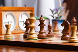 strategic chess game on wooden chess board