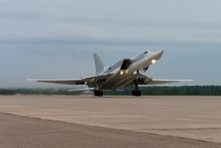 Strategic nuclear bomber is taking off from an airbase. Supersonic military bomber.