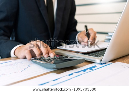 strategy analysis concept, Businessman working  financial Manager Researching Process accounting calculate analyse market graph data stock information review on the table in office Stockfoto ©