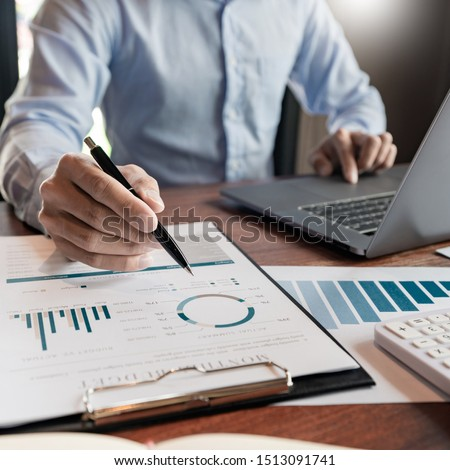strategy analysis concept, Businessman working  financial Manager Researching Process accounting calculate analyse market graph data stock information review on the table in office.