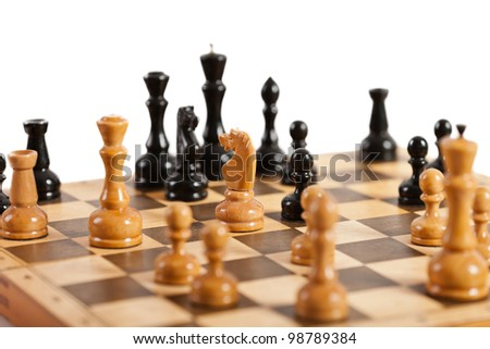 Strategy and competition chess game figures on wood board