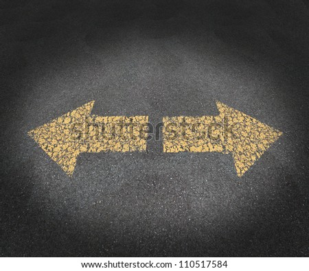 Strategy and decisions concept with a textured asphalt road and two old painted yellow arrows pointing in opposite directions as a business symbol of confusion and uncertainty in the future path.