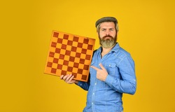 strategy ideas concept. bearded man hold chess board. intelligence quotient. human brain working. brainstorming concept. play chess tournament. Intelligence level measurement. level up your iq.