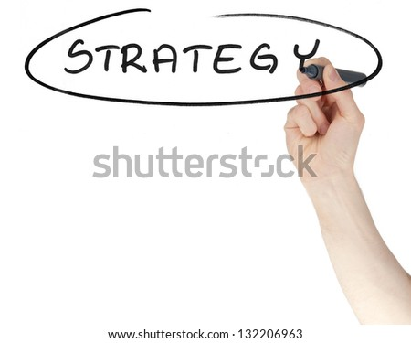Strategy sign written on a glass by a hand holding a felt tip pen