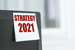 Strategy 2021 - text label on a computer monitor. A promising approach to achieve sustainable competitive advantage, search for new opportunities in business and education.