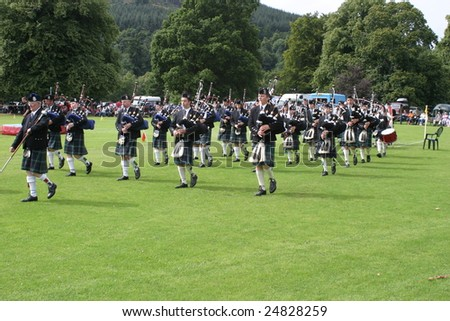 STRATHPEFFER, SCOTLAND - AUGUST, 9: bagpipes' parade at the Highland Games August 9, 2008 in Strathpeffer, Scotland.