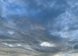 Stratocumulus Cloud Background Roll the clouds up in the sky Beautiful and unusual In the evening in Trang Province, Thailand.