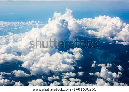 Stratosphere, view of clouds and the Earth from a height of 12,000 meters #1481690261