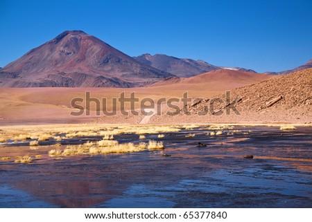 stratovolcano Cerro Colorado near Rio Putana in Atacama region, Chile - stock photo