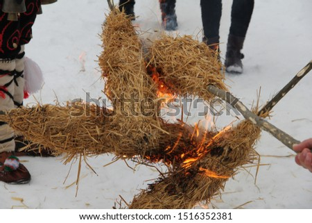 Straw and fire - a ritual of mummers chasing evil forces