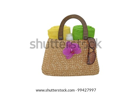 Straw bag, towels and sunglasses