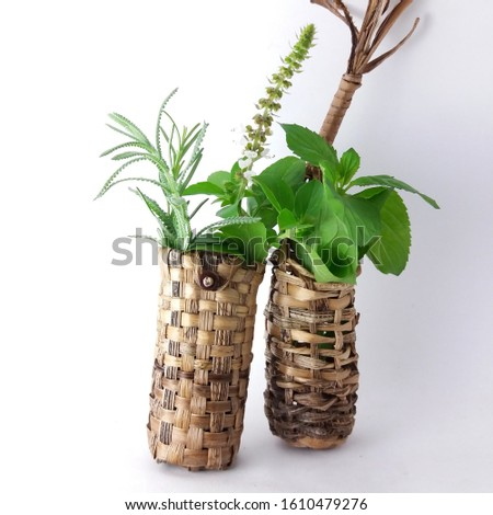 Straw basket and aromatic herbs