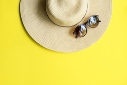 Straw Beach Woman's Hat Sun Glasses Top View Yellow Background Flat Single