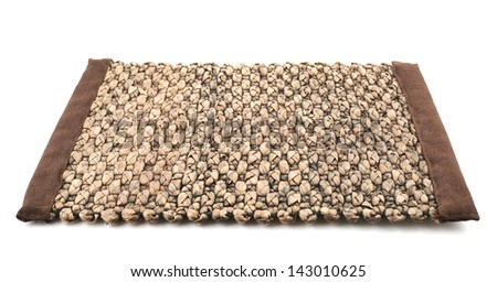 Straw brown wicker serving mat isolated over white background