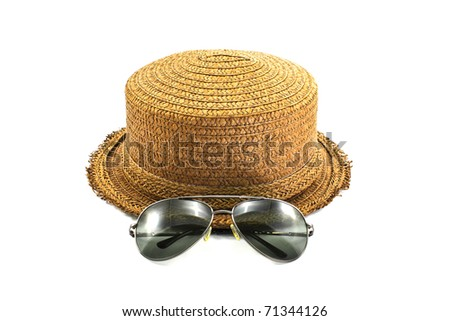 straw hat and sunglasses isolated on a white background