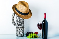 Straw hat ,cactus in room decoration at home, wine bottle and wine glass on white background. Home decor with copy space for your text. The concept of a healthy lifestyle, sport, diet.