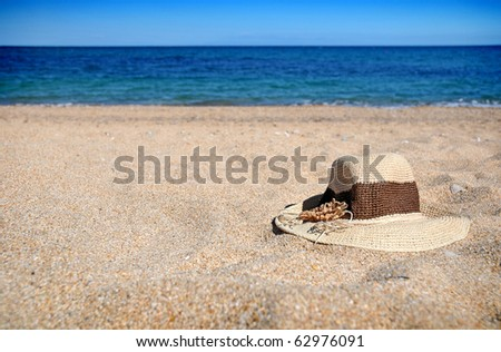 Straw hat lying in the sand on the beach