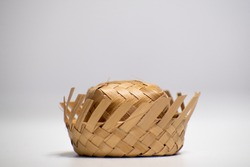 Straw hat on a white background. Traditional object used in the June festivities in Brazil. Known as